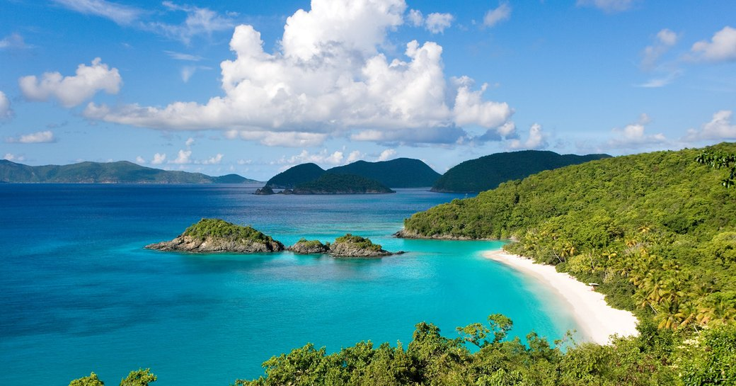 An image which shows the turquoise blue waters and white sands of a British Virgin Island beach