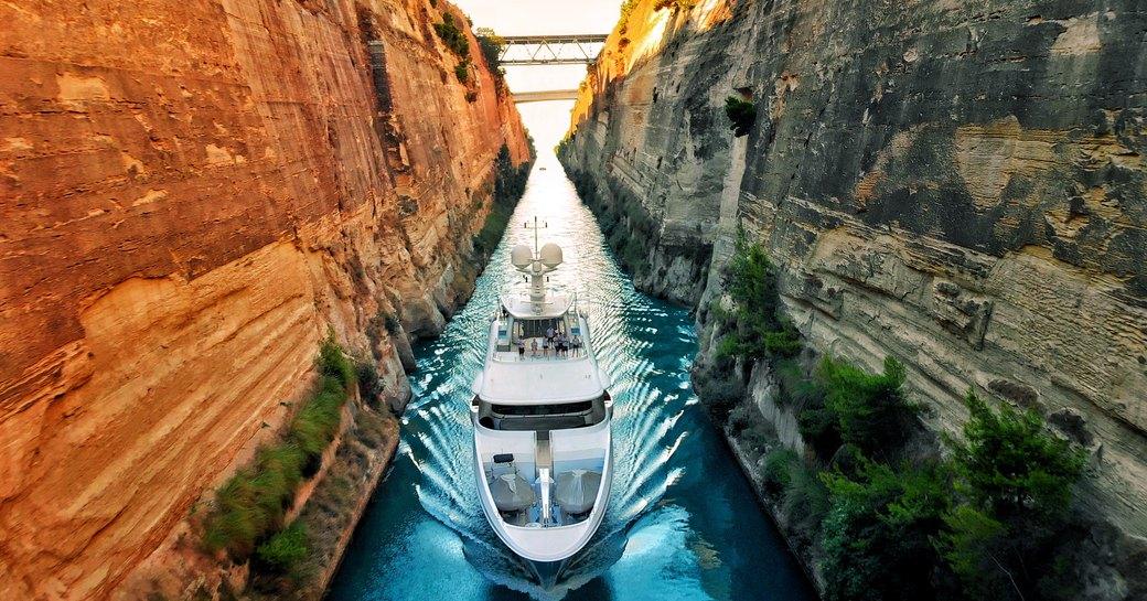 superyacht glides up corinth canal