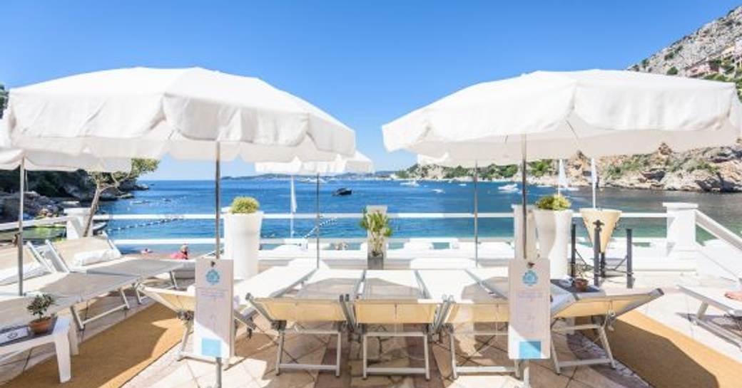 la reserve de mala beach club, with loungers and white parasols