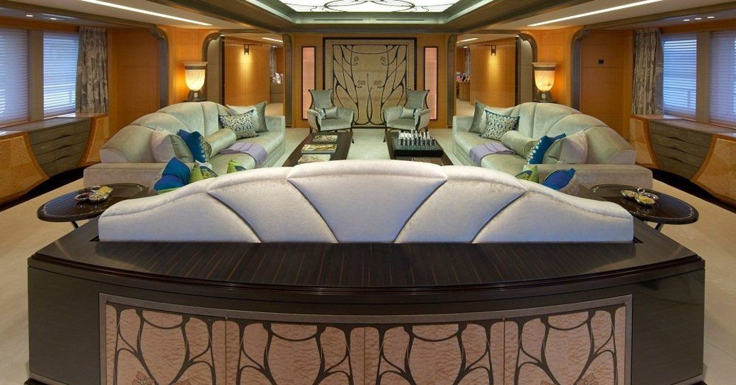 Lounge area onboard yacht charter AMARYLLIS, sofas facing each other with low coffee table between.