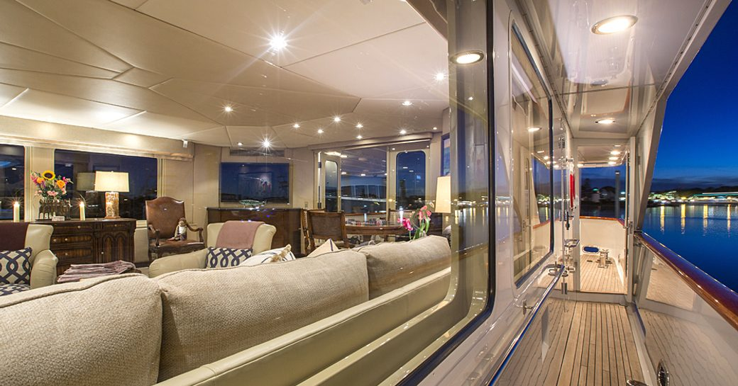 view of main salon of superyacht Sweet Escape from wrap-around deck