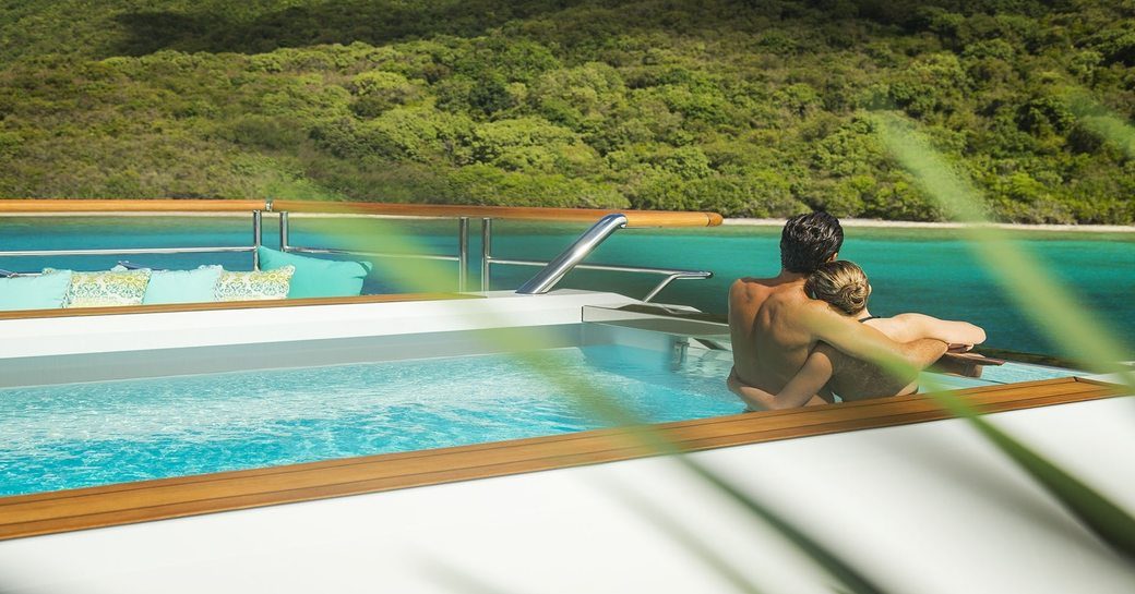Charter guests enjoying the pool on board superyacht SOLANDGE