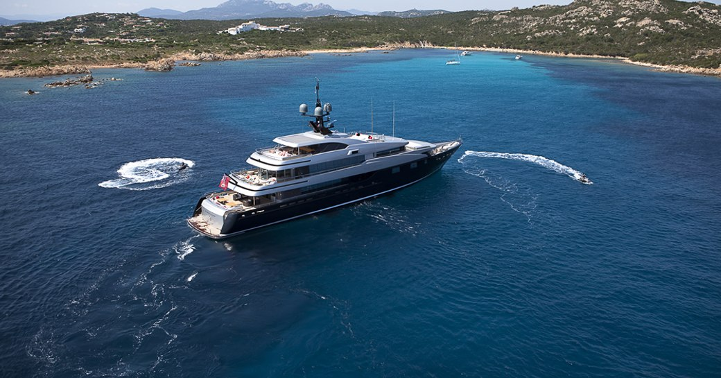 Superyacht SLIPSTREAM at-anchor with surrounding tenders