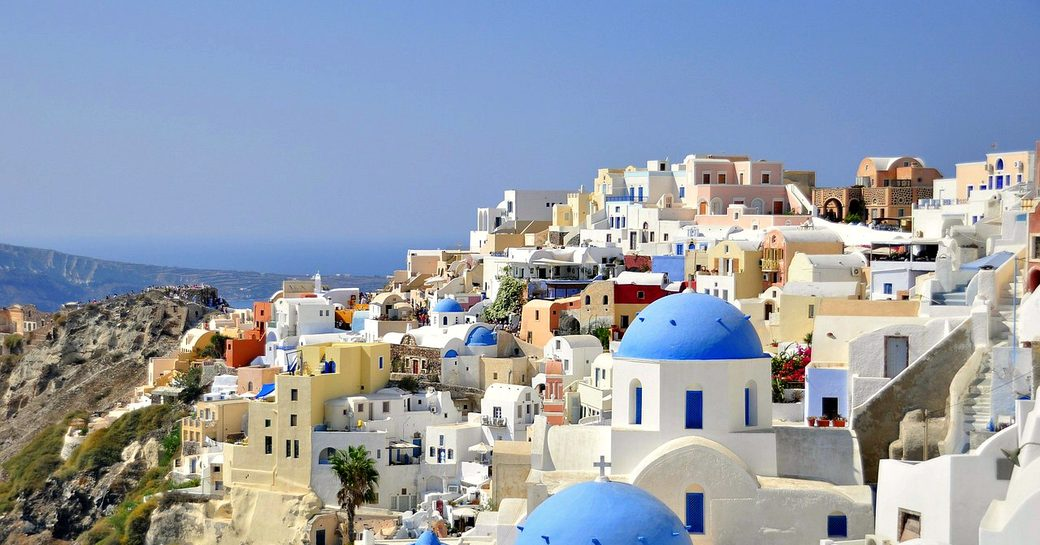 Charter yachts visit Santorini as part of Cyclades cruise