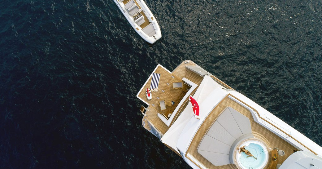 aft section of the sundeck aboard motor yacht CALYPSO with spa pool and sun pads