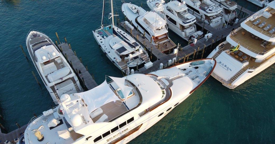 drone image of yachts at bay street marina during bahamas charter show