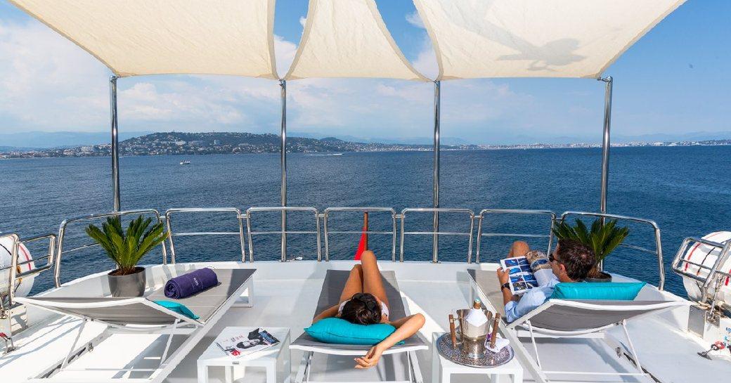 Luxury yacht DXB sun deck with sun loungers