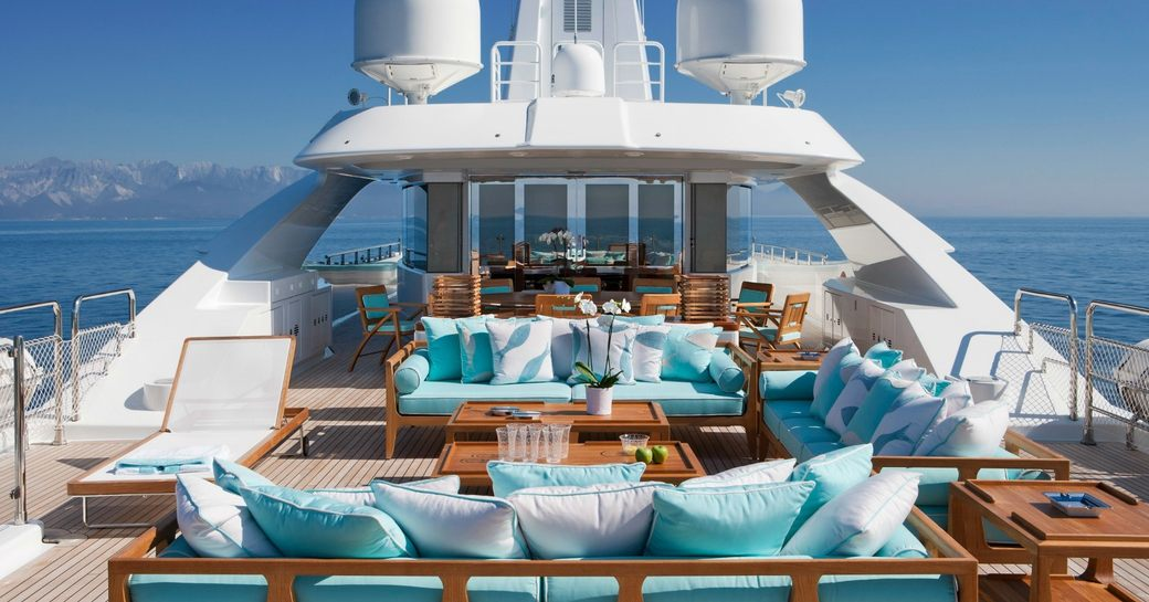 Blue and white furnishings on board the exterior of superyacht Ramble On Rose