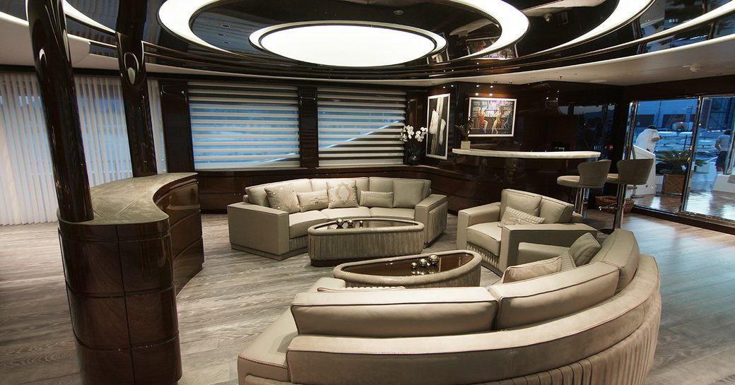 main salon and interiors on superyacht baba's with white sofa seating