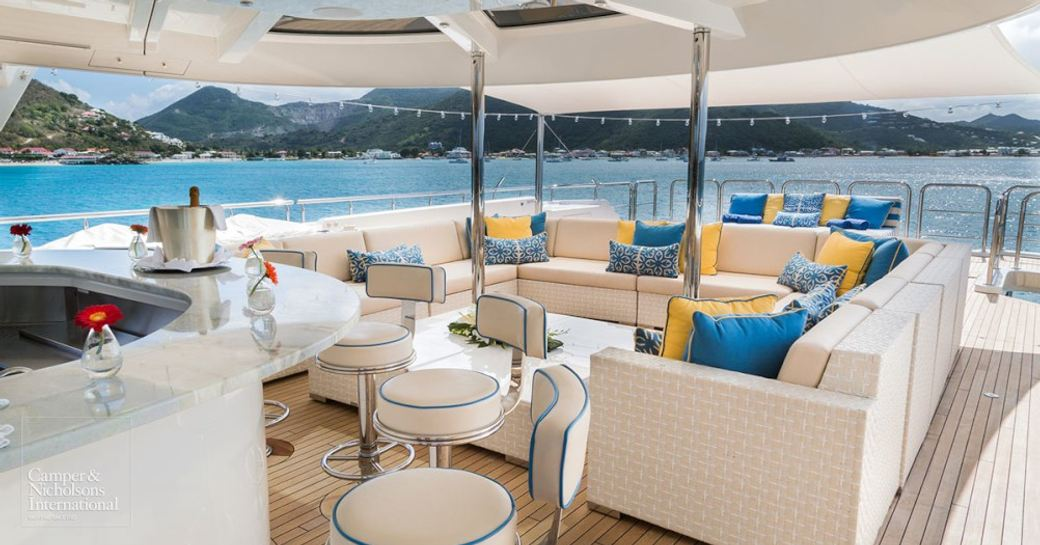 bar and shaded seating area on the sundeck of superyacht TRENDING