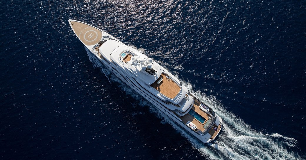 superyacht MADSUMMER by lurssen shipyard underway as she cruises deep waters on her charter through the Caribbean