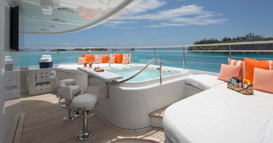 the 6 person jacuzzi of charter yacht time for us with a stunning view of the Bahas in the background