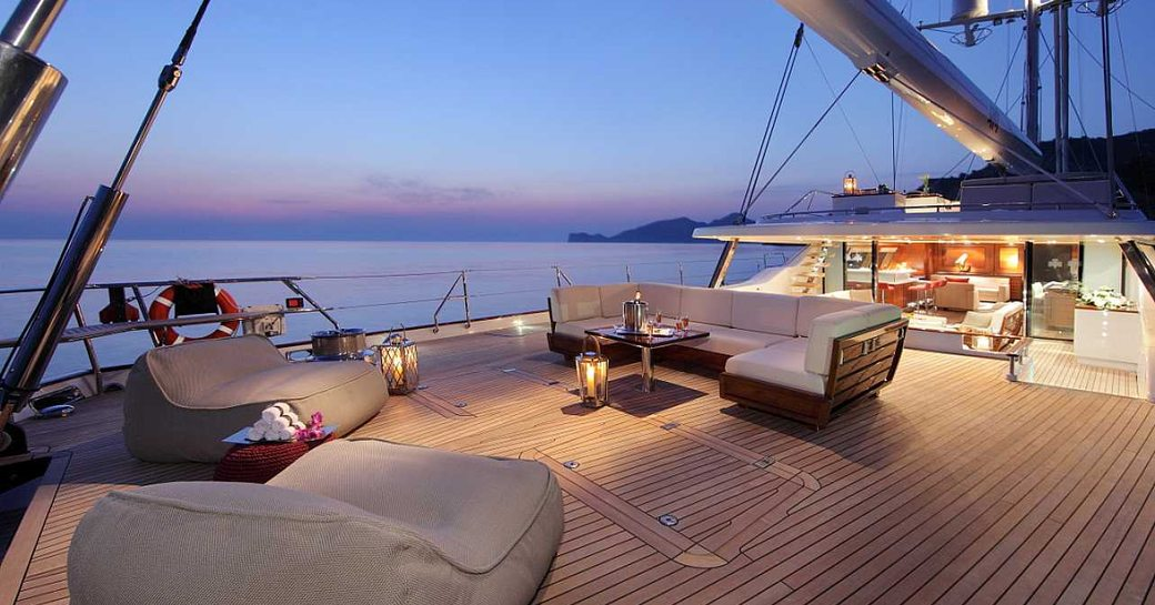 aft deck on charter yacht prana, with seating area in foreground and main salon in background