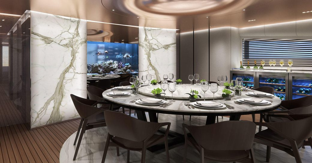 adamas 6 superyacht with marble dining table and aquarium