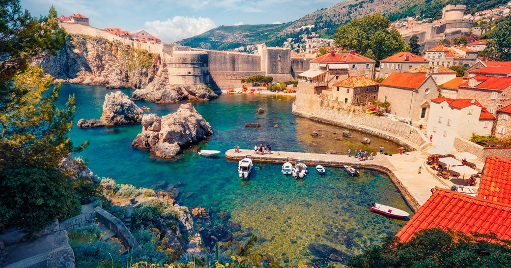 Сharm of the ancient cities of Europe. Aerial mornig view of Old Town from Fort Bokar. Picturesque summer cityscape of Dubrovnik. Sunny seascape of Adriatic sea, Croatia, Europe