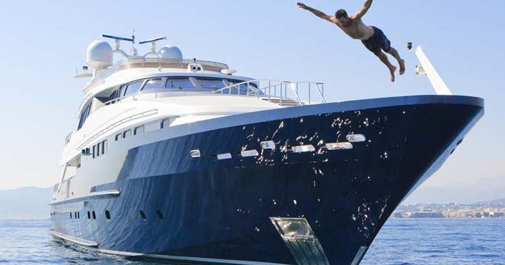 charter guest jumps from the bow of daloli yacht