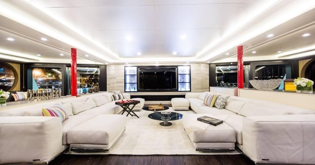 sumptuous sofas in the main salon of superyacht SALUZI
