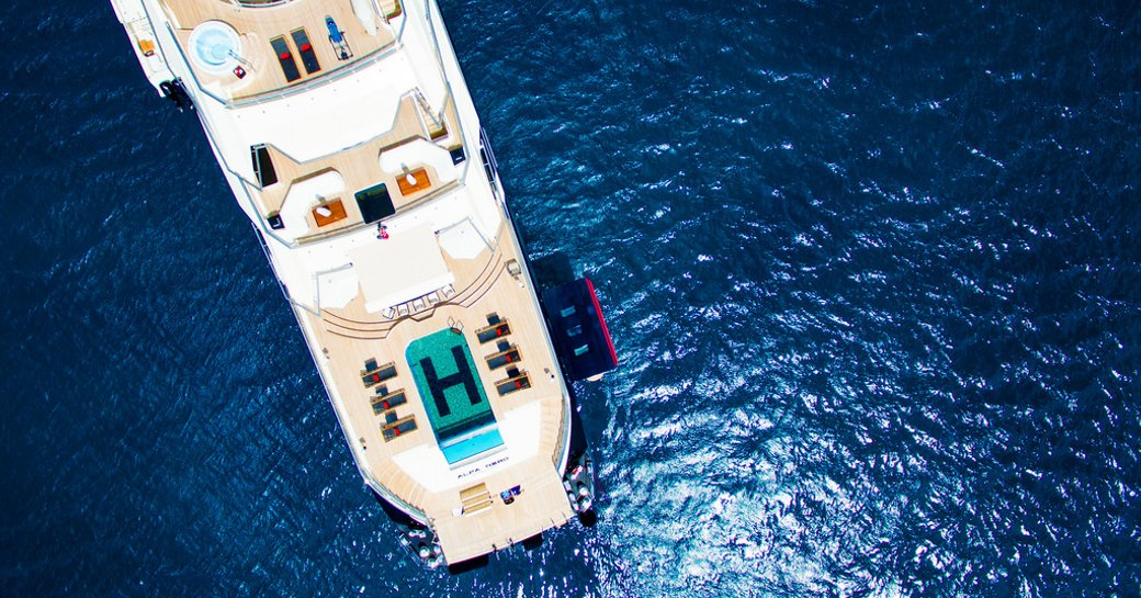 aerial view of the aft section of superyacht Alfa Nero with pool on main deck
