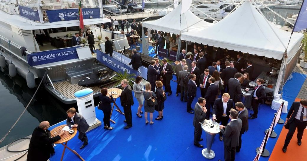 Participants of MIPIM around luxury yacht at the event in Cannes