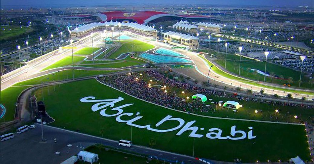 Aerial view of Yas Marina F1 racing circuit with Abu Dhabi carved into the grass