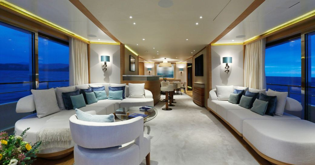 light, airy and modern main salon with sumptuous sofas on board superyacht SOLIS