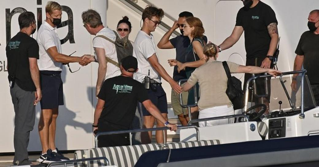 Crew arriving onboard MY Titania to shoots scenes for The Crown