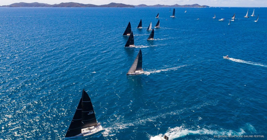 boats on the water in the bvi competing in regatta