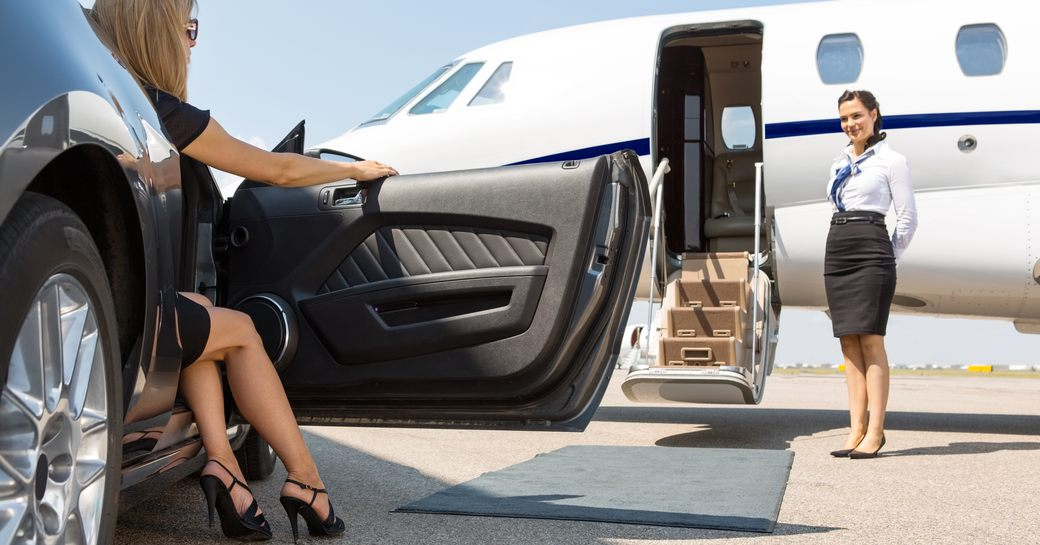 woman arrives to private jet practising social distancing