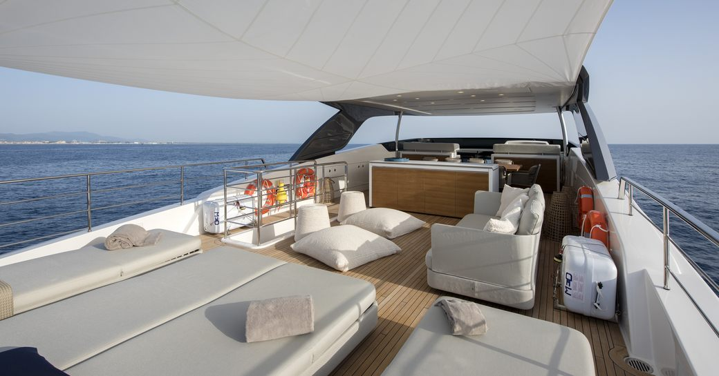 sunbeds and seating area on the aft section of the sundeck of motor yacht DINAIA