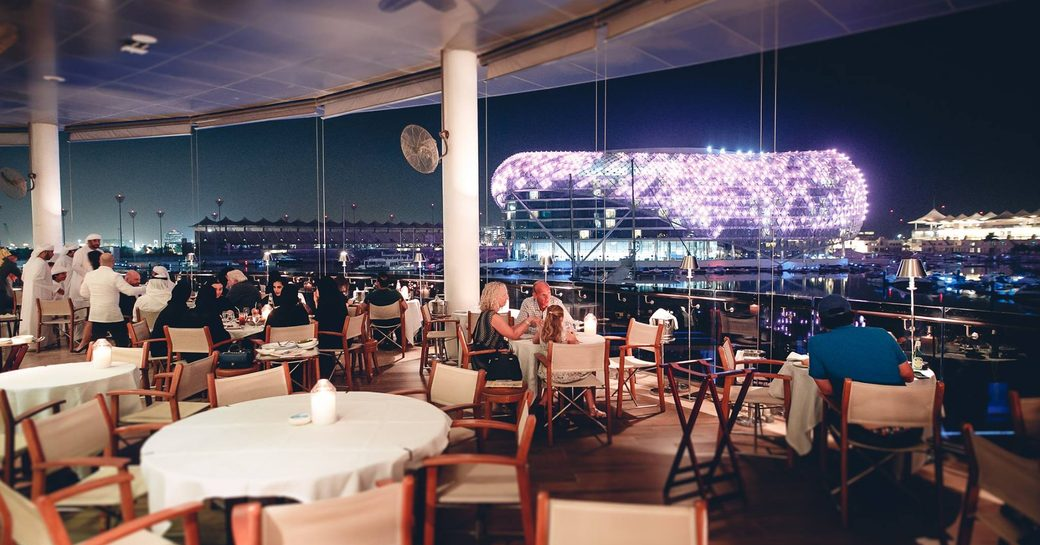 Restauarant and bar Cipriani on Yas Island in Abu Dhabi, with views over Yas Viceroy hotel lit up at night