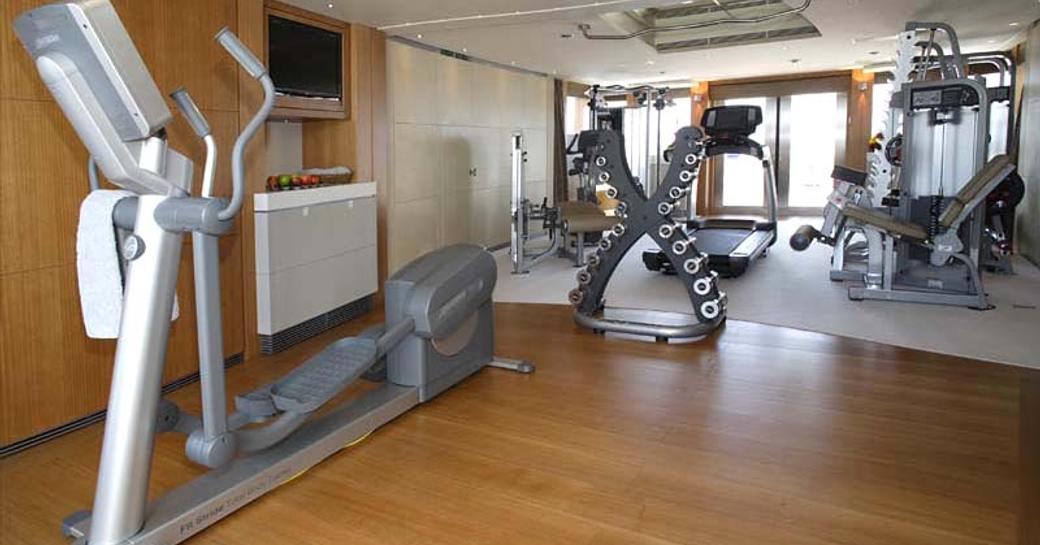 gym on board luxury yacht wheels