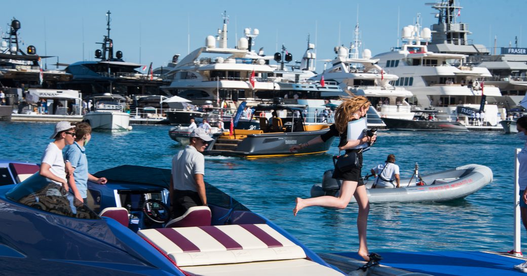 Tenders take visitors to anchored yachts at the MYS 2021