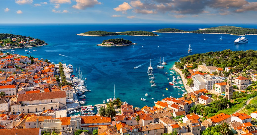 Overview of Hvar, Croatia. Elevated view looking out over rooftops towarda sea and archipelago.