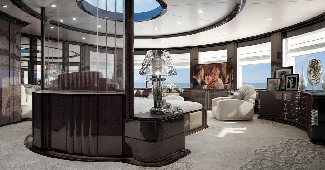 owner's suite on luxury charter yacht spectre, from benetti, with grey accents, glass furnishings, panoramic views and skylight