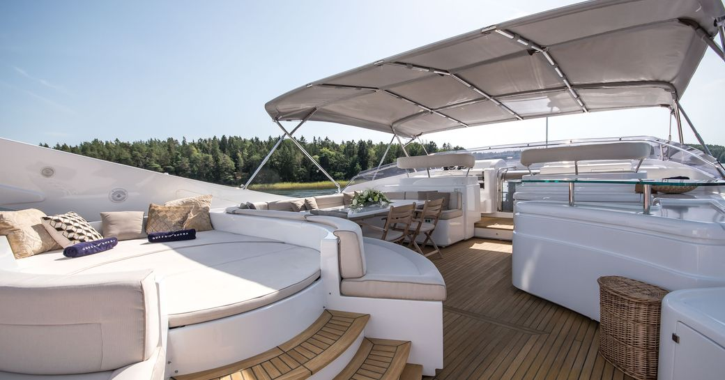 Sundeck on Superyacht Queen of Sheba, with light coloring and teak decking