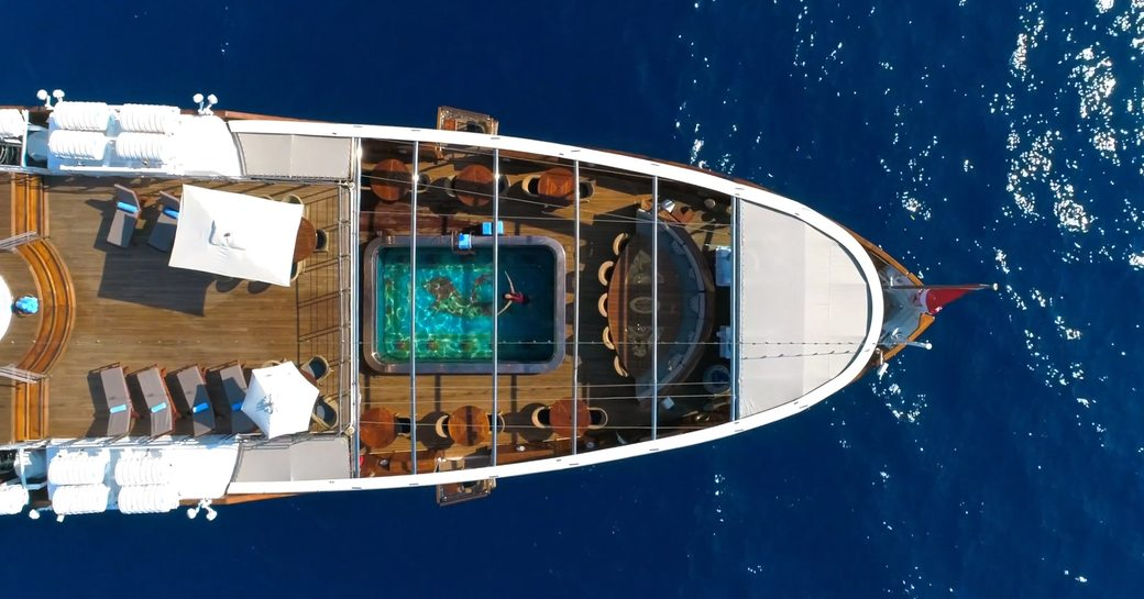 aerial shot of superyacht Christina O's classic and vintage custom mosaic pool