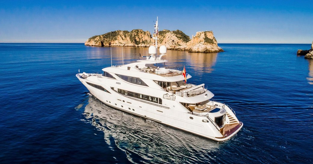 a superyacht cruises in some calm and quiet waters where they are away from major social spaces so the charterers can't contract coronavirus while on their luxury yacht charter