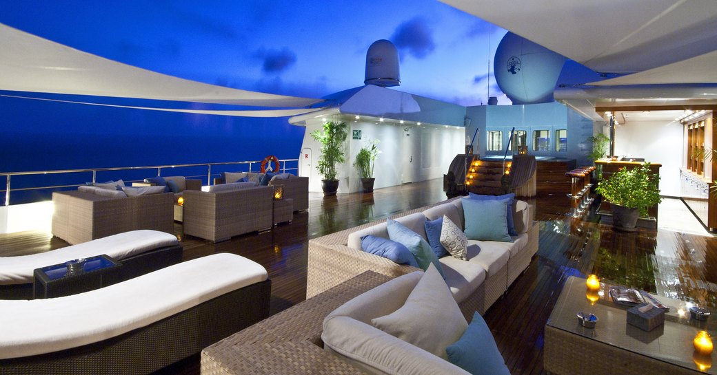chic sundeck with ample seating areas aboard luxury yacht 'Lauren L'