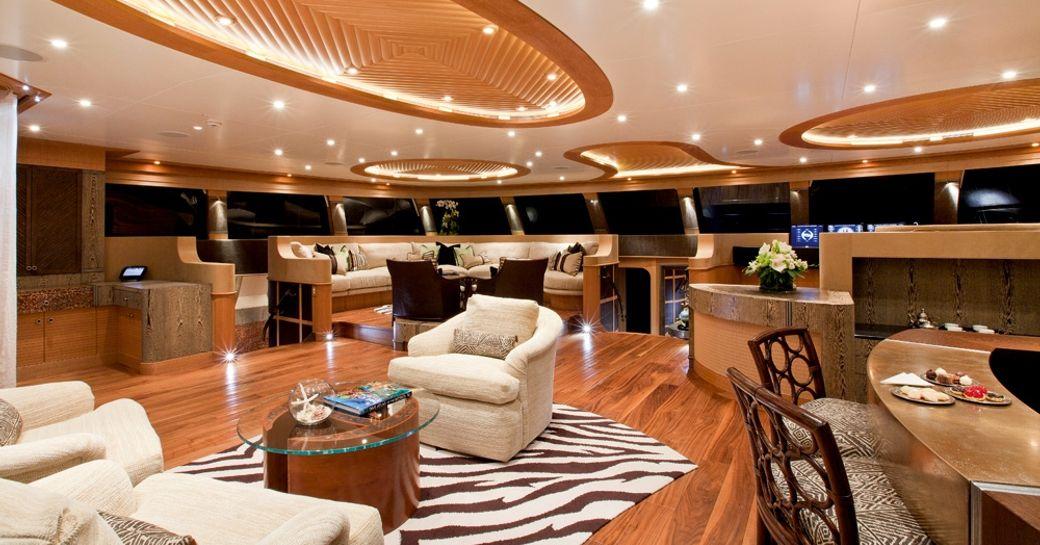 Polynesian-inspired main salon aboard charter yacht HEMISPHERE