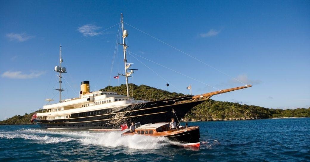 classic yacht NERO cruises alongside vintage style tender