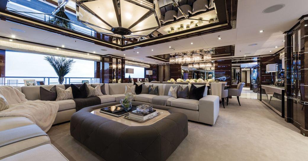 art deco-inspired main salon with huge U-shaped sofa on board superyacht 11/11
