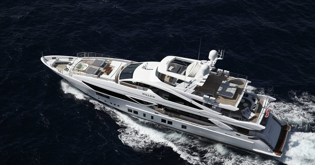 Luxury yacht WILLOW cruising from an aerial perspective