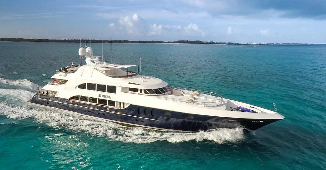 Profile shot of charter REBEL on the water with views of the Virgin Islands