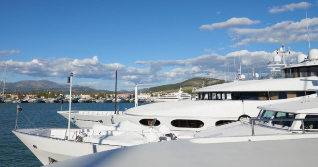 Line of charter yachts berthed at Mediterranean Yacht Show.