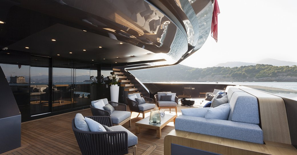 sumptuous seating on the main deck aft of superyacht 'Lucky Me'