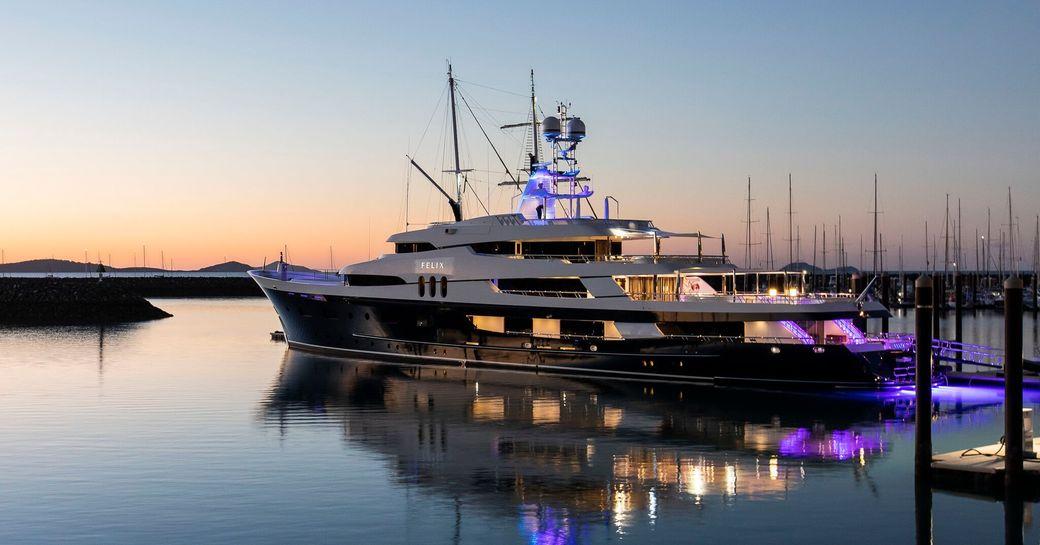Superyacht illuminated at sea at Coral Sea Marina Resort
