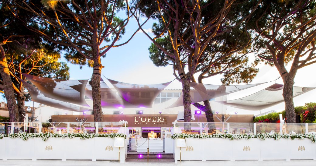 L'Opera restaurant in St Tropez, with pine trees and large alfresco terrace