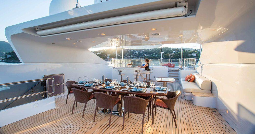 Sundeck dining area on luxury yacht DIANE