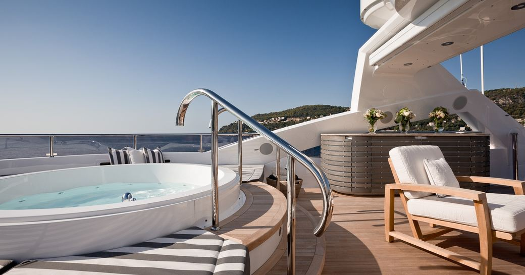 Superyacht THUMPER's deck Jacuzzi and sun loungers