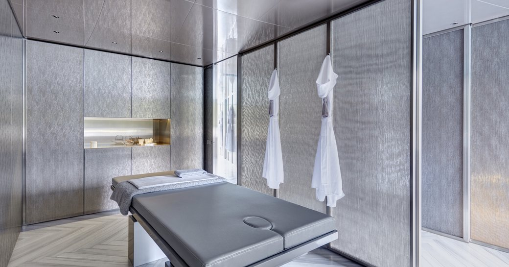 A silver massage bed surrounded by silver decor on board superyacht SAVANNAH